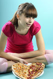 Teenager showing pizza Royalty Free Stock Photography