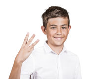Teenager showing three fingers, number three gesture Royalty Free Stock Image