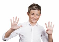 Teenager showing two hands, palms, fingers, making number nine. Portrait happy, smiling young man, teenager showing two hands, palms, fingers, making number nine Stock Image