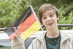 Teenager showing the victory gesture in front of a Stock Photo