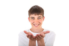 Teenager Shows his Palms. Handsome Teenager showing his Empty Palms Isolated On The White Background Royalty Free Stock Photo