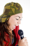 Teenager singer with microphone Stock Photo
