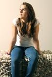 Teenager sit on sofa Stock Photo