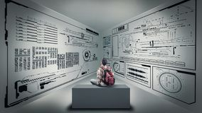 Studying informatics data. Teenager sitting on a box and studying the information wrriten on walls Royalty Free Stock Images