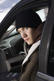 Teenager sitting in car. Stock Photos