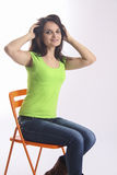 Teenager sitting on chair. classroom concept Royalty Free Stock Photo