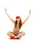 Teenager sitting on the floor Stock Photography
