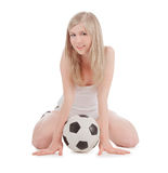 Teenager sitting on floor with soccer ball Stock Images