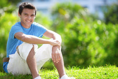 Teenager sitting in the park Stock Photography