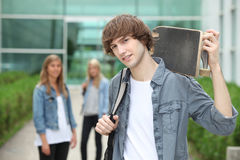 Teenager with skate-board Stock Photos