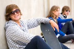 Teenager with skateboard Royalty Free Stock Image