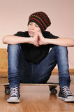 The teenager with a skateboard Royalty Free Stock Photos