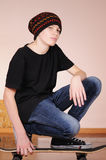 The teenager with a skateboard Royalty Free Stock Photography