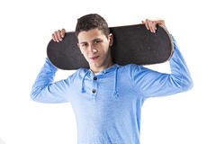 Teenager with a skateboard Royalty Free Stock Photography