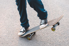 Teenager on a skateboard Stock Photography