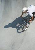 Teenager at Skateboard Park. Teenager on Dirt Bike at Skateboard Park Royalty Free Stock Image
