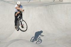 Teenager at Skateboard Park. Teenager on Dirt Bike at Skateboard Park Stock Photo