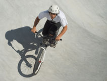 Teenager at Skateboard Park. Teenager on Dirt Bike at Skateboard Park Stock Photography