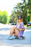 Teenager with skateboard portrait outdoors Royalty Free Stock Images