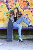 Teenager with skateboard Stock Images