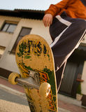 Teenager skateboarding. A young teen skateboarding and having fun in a suburban setting Royalty Free Stock Photos