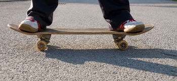 Teenager skateboarding. A young teen skateboarding and having fun in a suburban setting Stock Photo