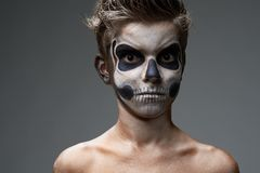 Teenager with skull makeup shirtless Royalty Free Stock Photo