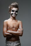Teenager with skull makeup worth arms crossed Stock Images