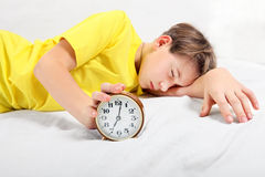 Teenager sleep with Alarm Clock Stock Images