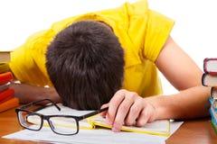 Teenager sleep on the Books. Tired Teenager sleep on the Books Isolated on the White Stock Image