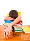 Teenager sleep on the Books. Tired Teenager sleep on the Books Isolated on the White Royalty Free Stock Photography
