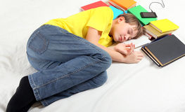 Teenager sleep with a Books Stock Images