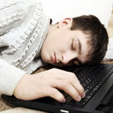 Teenager sleep on Laptop Royalty Free Stock Image