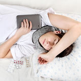 Teenager sleep with Tablet Computer Stock Images