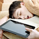 Teenager sleep with Tablet Stock Photography