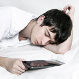 Teenager sleep with Tablet Stock Photos