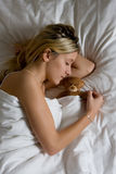 Teenager sleeping in bed Stock Photography