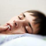 Teenager sleeping Stock Photo