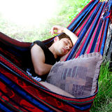 Teenager sleeping in the Hammock. On the Nature Stock Photos
