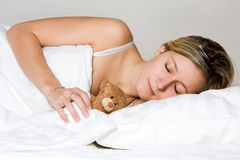 Teenager sleeping with teddy royalty free stock photography