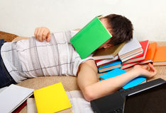 Teenager sleeps with the Books Stock Images