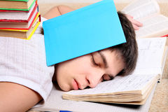 Teenager sleeps on the Books Royalty Free Stock Image