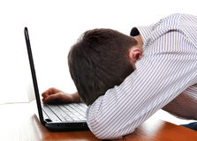 Teenager sleeps on Laptop Stock Photo