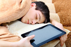 Teenager sleeps with Tablet Computer Stock Photography