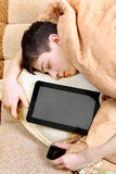 Teenager sleeps with Tablet Computer Stock Images