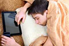 Teenager sleeps with Tablet Stock Photos