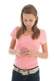 Teenager with smartphone. Isolated over white background Stock Photo