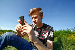 Teenager with smartphone Stock Image