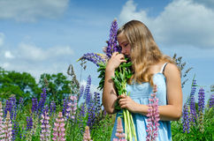 Teenager smelling the flowers Stock Photos