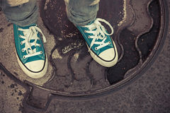 Teenager in sneakers. Feet in gumshoes, old style Stock Photo